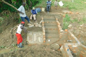 The Water Project: Sambaka Community, Sambaka Spring -  Rub Wall Construction