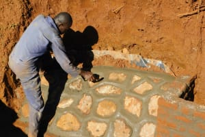 The Water Project: Emulembo Community, Gideon Spring -  Rub Wall Construction