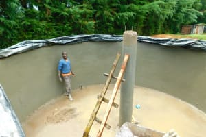 The Water Project: Kapkures Primary School -  Artisan Steps Back To Assess His Work