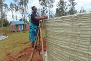The Water Project: Demesi Primary School -  Field Officer Karen Maruti Inspecting Work