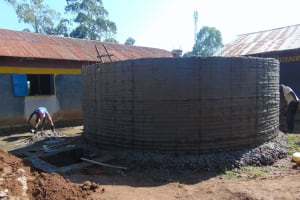 The Water Project: Nanganda Primary School -  Outside Of Tank Gets Cement And Drawing Point