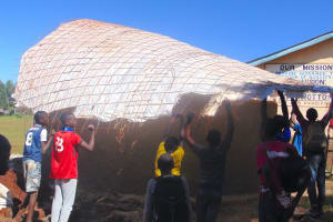 The Water Project: Kakamega Muslim Primary School -  Students Help Raise The Dome Form Onto The Tank