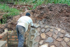The Water Project: Masuveni Community, Masuveni Spring -  Second Rub Wall Gets Cement