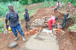The Water Project: Munenga Community, Francis Were Spring -  Artisan Enjoying His Work