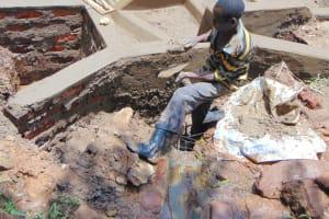 The Water Project: Masuveni Community, Masuveni Spring -  Cementing Interior Of Spring Box