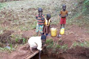 The Water Project: Shikhombero Community, Atondola Spring -  Fetching Water