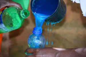 The Water Project: Mukuku Community A -  Pouring Soap