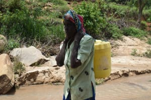 The Water Project: Nduumoni Community A -  Carrying Container Filled With Water