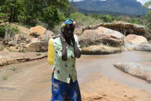 The Water Project: Nduumoni Community A -  Carrying Water