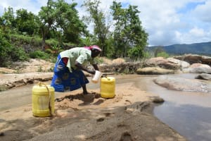 The Water Project: Nduumoni Community A -  Collecting Water At The River