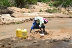The Water Project: Nduumoni Community A -  Scooping Water