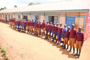The Water Project: Kavyuni Salvation Army Primary School -  Students Lined Up With Their Water Containers