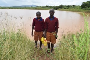 The Water Project: Kavyuni Salvation Army Primary School -  Students Stand In Front Of Open Water Source