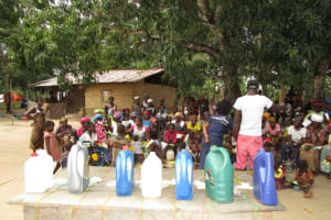The Water Project: Mathem Community -  Containers Lined Up For Tippy Tap Construction