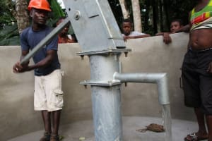 The Water Project: Mathem Community -  Pumping The Well After Installation