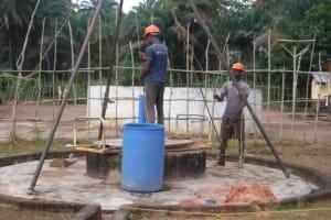 The Water Project: Lokomasama, Menika, DEC Menika Primary School -  Bailing