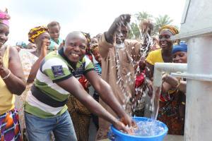 The Water Project: Lokomasama, Menika, DEC Menika Primary School -  Principal Celebrates The Completed Well