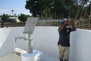 The Water Project: Lokomasama, Menika, DEC Menika Primary School -  Pumping Water After Installation
