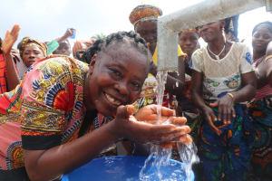 The Water Project: Lokomasama, Menika, DEC Menika Primary School -  School Head Teacher Drinks From The Well