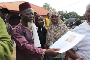 The Water Project: Lungi, Masoila, #3 Kamara Street -  Chief Imam Looking At Miralems Picture