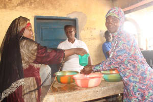 The Water Project: Lungi, Masoila, #3 Kamara Street -  Handwashing Demonstration With Community Member