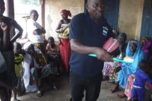 The Water Project: Lungi, Masoila, #3 Kamara Street -  Hygiene Facilitator Discusses Toothbrushing
