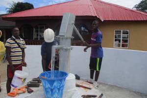 The Water Project: Lungi, Masoila, #3 Kamara Street -  Testing The Pump After Its Installation