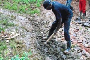 The Water Project: Kimarani Community, Kipsiro Spring -  Digging Cutoff Drainage Above The Spring Site