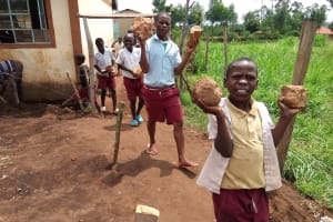 The Water Project: Mulwanda Mixed Primary School -  Pupils Carry Stones For Construction