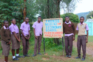 The Water Project: Friends Musiri Secondary School -  Students Pose With School Sign At Entrance