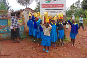 The Water Project: Kitagwa Primary School -  Students With Water At School Gate