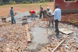 The Water Project: Ebukhuliti Primary School -  Pouring Cement Foundation