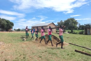 The Water Project: Mwichina Primary School -  Students Carry Lumber For Construction