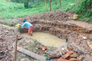 The Water Project: Bumira Community, Imbwaga Spring -  Excavation Begins