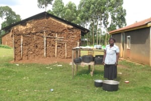 The Water Project: Mwikhupo Primary School -  School Cook Washes Dishes At The Dishrack