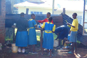 The Water Project: Gimomoi Primary School -  Students Help The School Cook With Dishes
