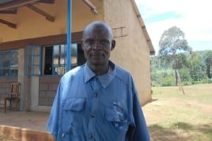 The Water Project: St. Peters Bwanga Primary School -  Teacher Sir Nicholas Yasisi