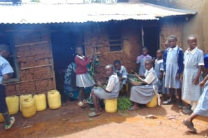 The Water Project: Saosi Primary School -  Pupils Outside Kitchen Helping Prepare Vegetables