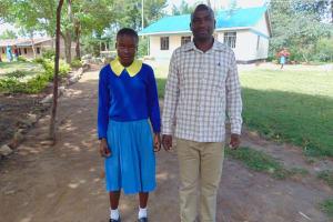 The Water Project: Shikomoli Primary School -  Student Ivy And Head Teacher Mr Bethuel Burmen