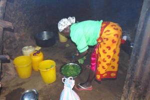 The Water Project: Jimarani Primary School -  School Cook At Work Inside Kitchen