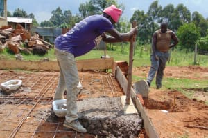 The Water Project: Kosiage Primary School -  Tamping Down Concrete Around Recepticles