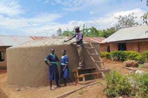The Water Project: Mukama Primary School -  Girls Pose With Rain Tank In Progress
