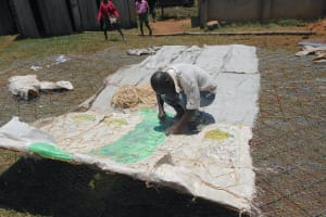 The Water Project: Ebukhayi Primary School -  Tying Dome Wire To Sugar Sacks