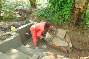 The Water Project: Imbinga Community, Imbinga Spring -  Stone Pitching