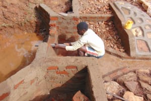 The Water Project: Jivovoli Community, Magumba Spring -  Pipe Setting