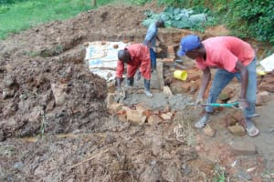 The Water Project: Bumira Community, Imbwaga Spring -  Artisan Works On The Stairs