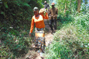 The Water Project: Kisasi Community, Edward Sabwa Spring -  Community Members Carry Materials To Site