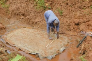The Water Project: Busichula Community, Marko Spring -  Artisan Measures Concrete Foundation