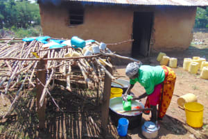 The Water Project: Jimarani Primary School -  School Cook Washes Dishes At Dishrack