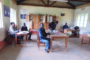 The Water Project: St. Joakim Buyangu Primary School -  Teacher In The Staffroom